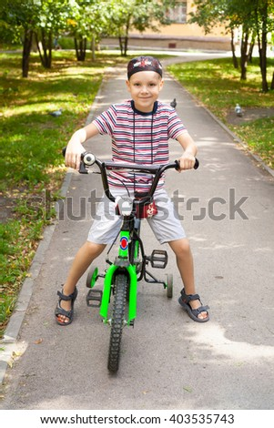 cute little boy riding the bicycle - stock photo