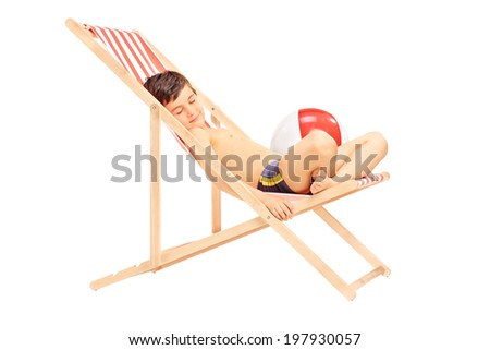 Cute little boy sleeping in a sun lounger isolated on white background - stock photo