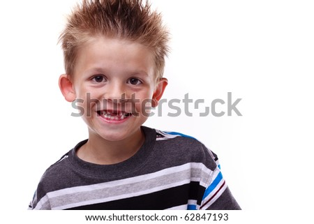 Cute little boy smiling and showing his missing teeth on a white background - stock photo
