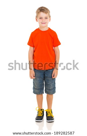 cute little boy standing on white background - stock photo