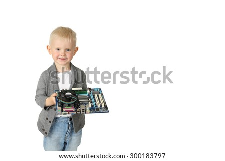Cute little boy stands with computer circuit board in his hands isolated on white background with copy space for text - stock photo