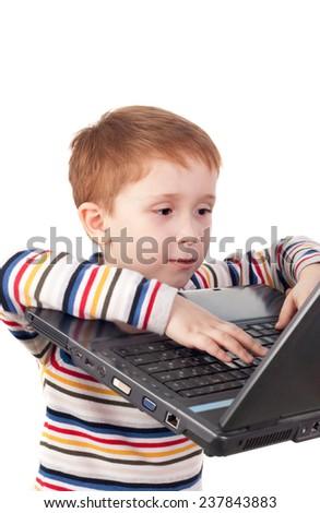cute little boy surfing in internet - stock photo