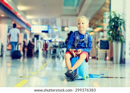 cute little boy waiting in the airport, child travel - stock photo