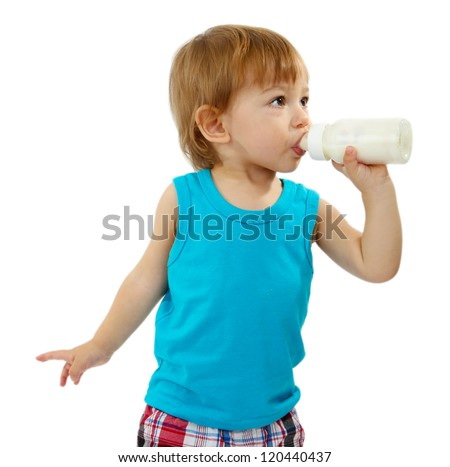 cute little boy with bottle of milk, isolated on white - stock photo
