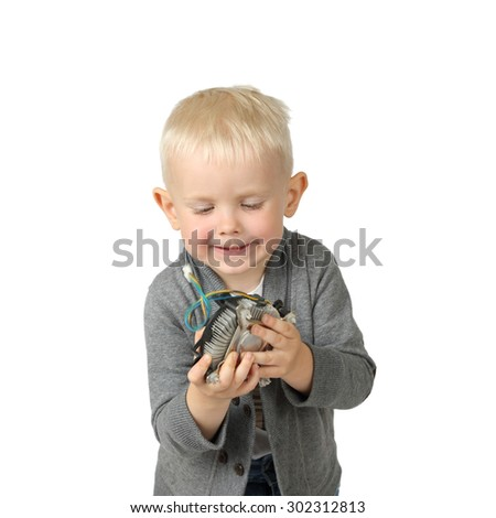 Cute little boy with computer item in hands isolated on white background with focus on face - stock photo
