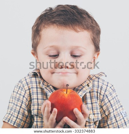 Cute little boy with red apples, isolated over white. Concept of healthy life. - stock photo