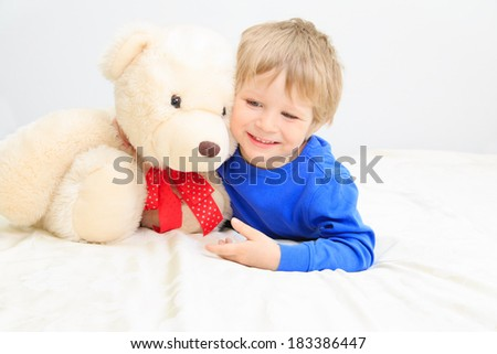 cute little boy with teddy bear - stock photo