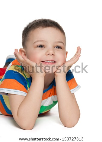 Cute little boys are lying on the floor and looks aside - stock photo