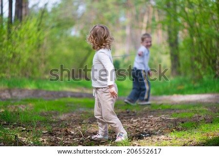 Cute little brother and sister at summer forest - stock photo