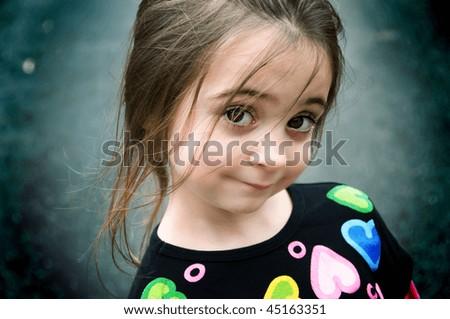 Cute little brunette, brown-eyed girl - stock photo