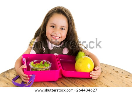 Cute little brunette girl with her healthy lunchbox isolated on white - stock photo