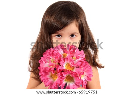 Cute little brunette three year old girl holding and hiding behind flowers being shy on a white background - stock photo