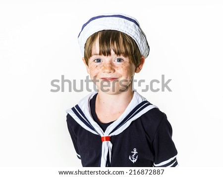 Cute little carroty boy dressed in sailor suit - stock photo