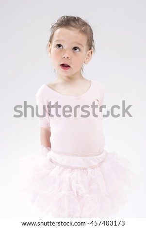 Cute Little Caucasian Blond Child with Curious Expression Looking Upwards.Vertical Image Orientation - stock photo