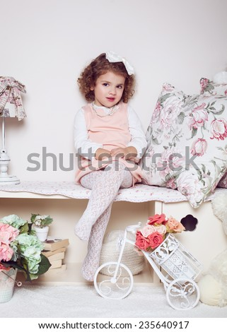 Cute little child girl sitting indoors in her room - stock photo