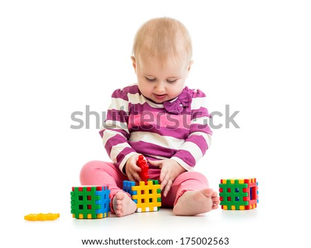 Cute little child is playing with toys - stock photo