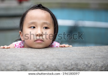 Cute little chinese girl playing at park - stock photo