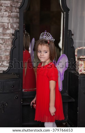 Cute little girl about four years old in fairy costume - stock photo