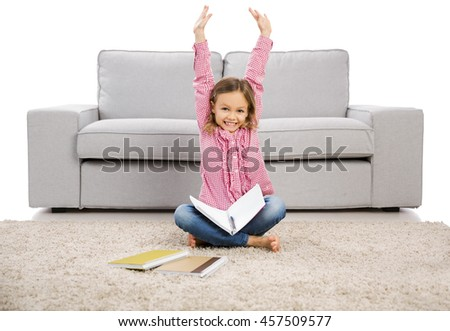 Cute little girl at home studying - stock photo