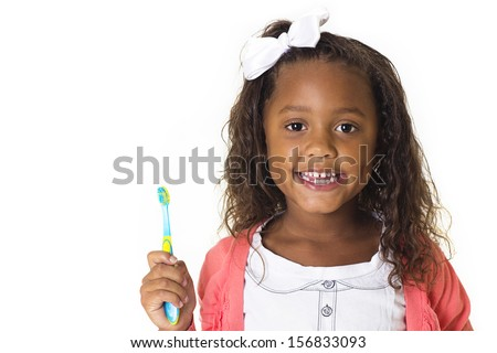 Cute Little Girl Brushing her teeth - stock photo