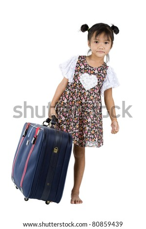 cute little girl carrying her luggage over white background - stock photo
