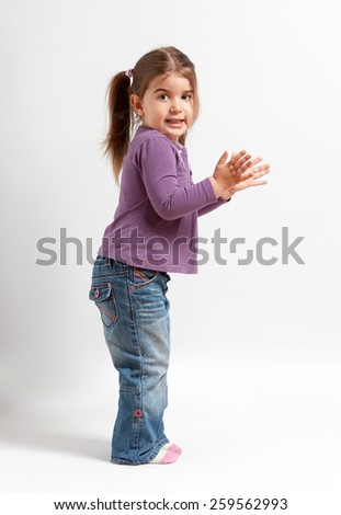 Cute little girl clapping - stock photo