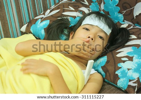 Cute  little girl coughing on bed ,Selective focus - stock photo