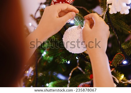 Cute little girl decorating Christmas tree  - stock photo