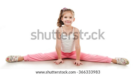 Cute little girl doing gymnastic exercise isolated on a white - stock photo
