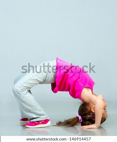 Cute Little girl doing gymnastics exercise - stock photo