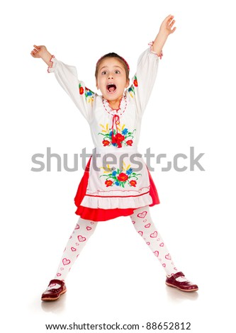 cute little girl dressed in traditional Ukrainian screaming - stock photo