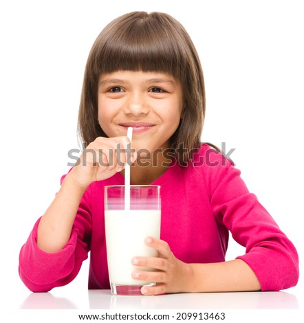 Cute little girl drinks milk using drinking straw, isolated over white - stock photo