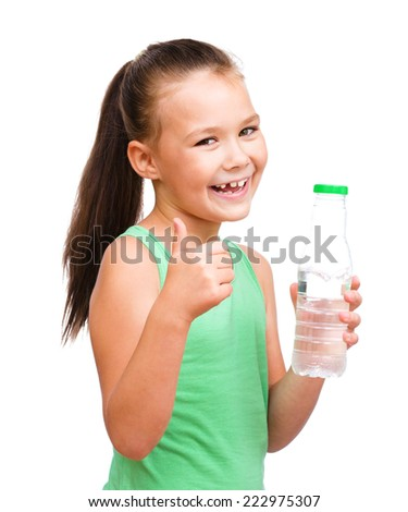 Cute little girl drinks water from a plastic bottle, isolated over white - stock photo