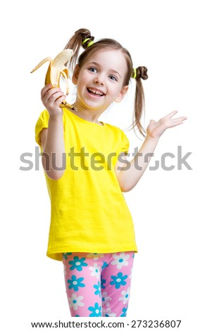 cute little girl eating banana isolated on white - stock photo