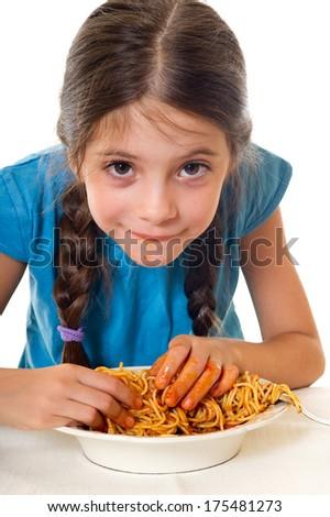 cute little girl eating spaghetti - stock photo