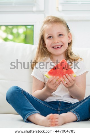 Cute little girl eating watermelon - stock photo