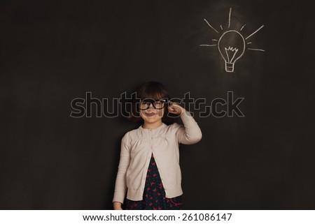cute little girl has an new idea - stock photo