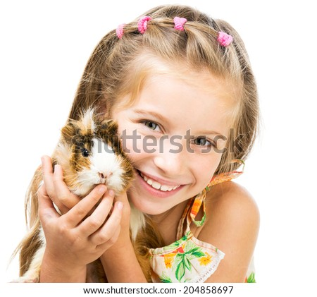 Cute little girl holding a guinea pig. Isolated on white background. - stock photo