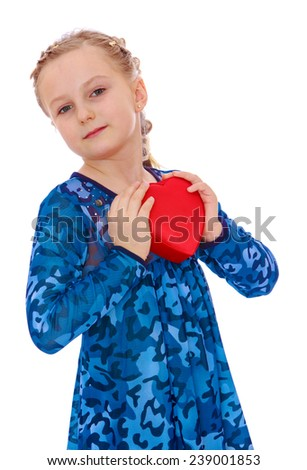 Cute little girl holding a heart. Studio photo, isolated on white background. - stock photo