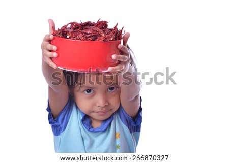 cute little girl holding dry pepper on bowl. Isolated white - stock photo