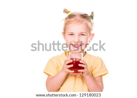Cute little girl holding glass with juice smiling isolated on white - stock photo