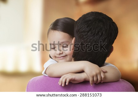 Cute little girl hugging her father - stock photo