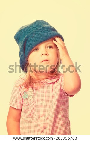 Cute little girl in a blue hat, isolated - stock photo