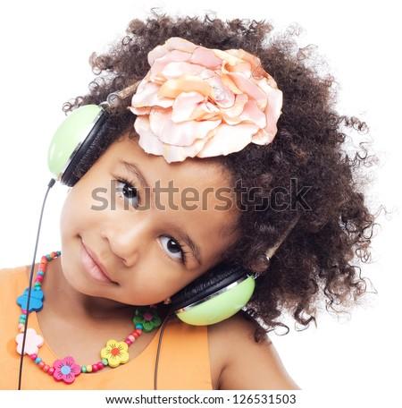 Cute little girl in big headphones - stock photo