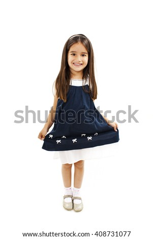 Cute little girl in dress smiling on camera. Isolated on a white background  - stock photo