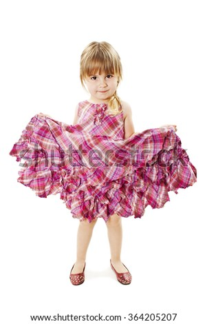 Cute little girl in dress smiling on camera. Isolated on white background - stock photo
