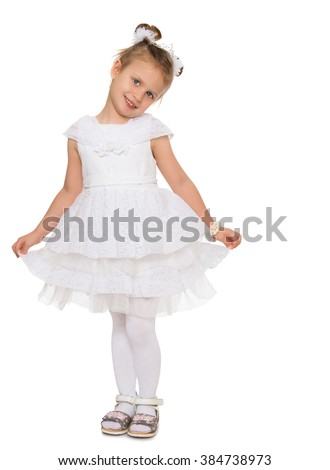 Cute little girl in fancy white dress gown holds his hands over the edge - Isolated on white background - stock photo
