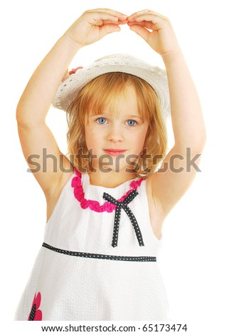 Cute little girl in hat and nice dress  dancing with hands, isolated on the white background portrait, stoodio shoot. - stock photo