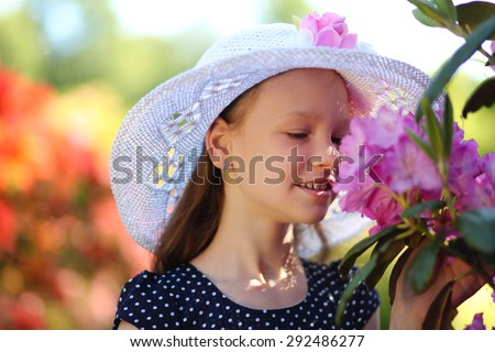 cute little girl in park - stock photo