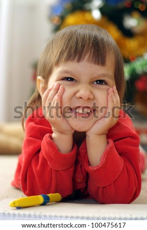 cute little girl in red clothes drawing - stock photo
